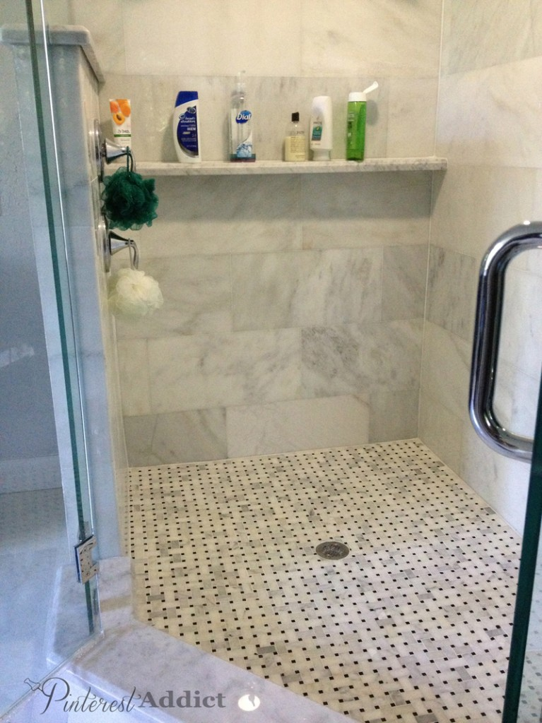 Basket weave marble floor and marble shower shelf