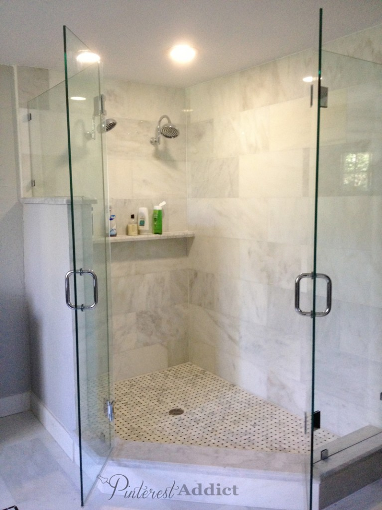 Double shower heads - marble shower shelf - basket weave tiles