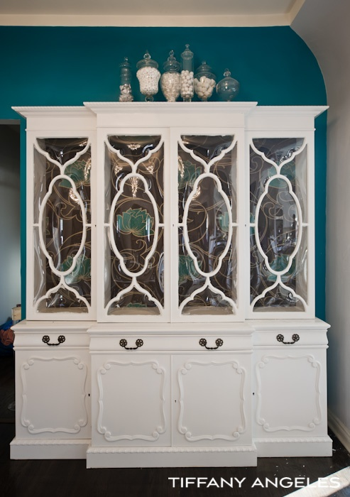 White china cabinet with wallpaper