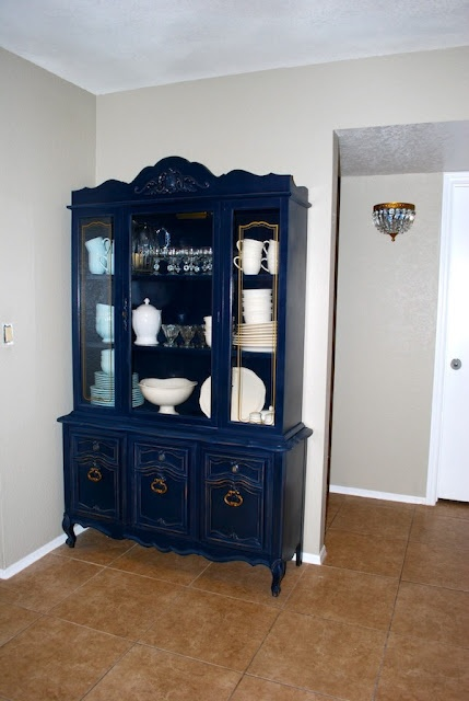 Navy blue china cabinet via Classy Clutter