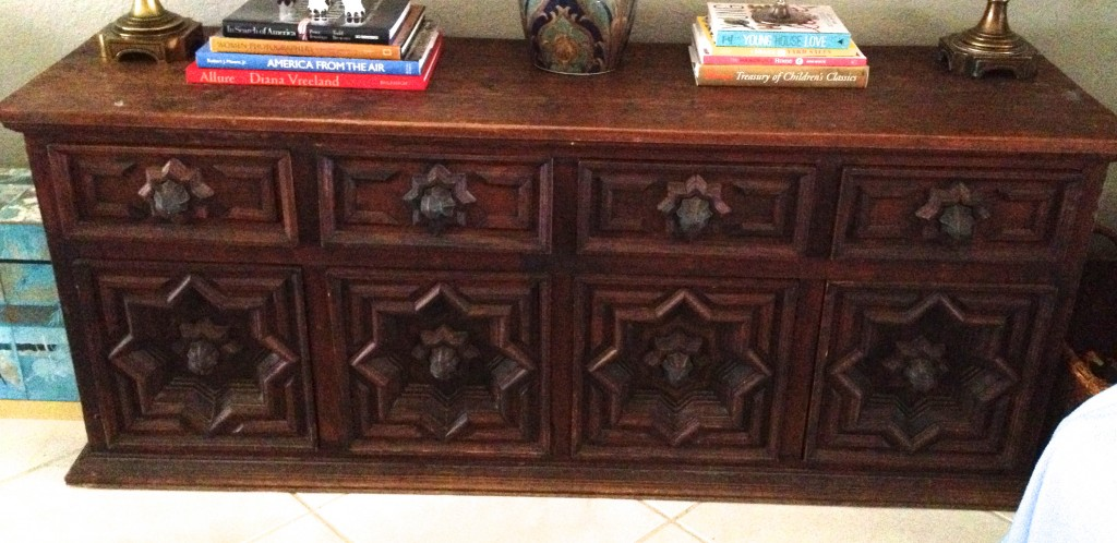 Made in Mexico, this buffet was made of heavy, thick wood, and iron drawer and door pulls. It is a gorgeous piece, just not for my house