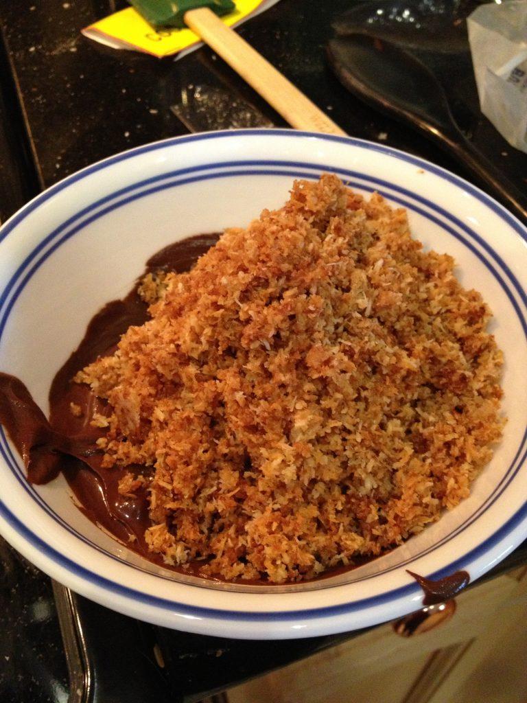 Add coconut to chocolate - stir