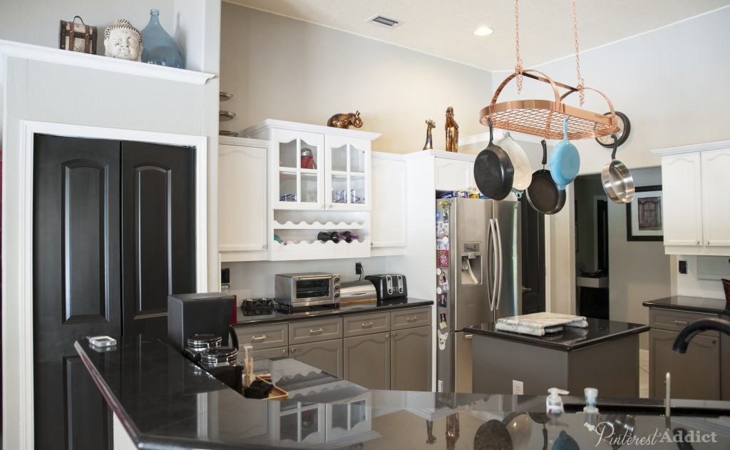 What a difference painting the kitchen cabinets made to this space! Kitchen update black doors